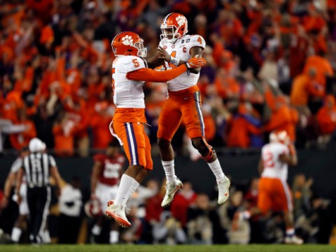 Clemson's Deshaun Watson and Shaq Smith (5) celebrate a last second touchdown during the second half of the NCAA college football playoff championship game against Alabama Tuesday, Jan. 10, 2017, in Tampa, Fla. (AP Photo/John Bazemore)